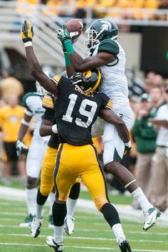 unior wide receiver Tony Lippett jumps for a catch as Iowa defensive back B.J. Lowery covers, Oct. 5, 2013, at Kinnick Stadium. The Spartans...