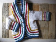Based on a vintage cardigan! Base color can be selected. Borders will be multicolor.  This is not knitted but crochet!  Made from a 100% cotton with Aloe Vera for a super soft finish #crochet baby cardigan
