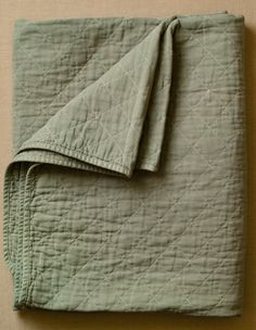 quilted throws (utility canvas) from purl soho.  I love these, i want these, but i do not need more throw blankets.