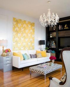 i LOVVEEE this! Great way to decorate a wall when you can't paint or do wall papering, and i love the chandelier and little coffee table Pattern love apartment living room.