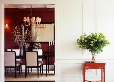 Love the dramatic dining room set against the white wainscoting...