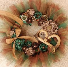 Got a hunter in the family? Decorate for hunting season and show your support of your hunters hobby with this camouflage wreath! Camo has never