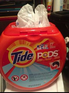 Stuffing plastic bags in an empty Tide Pods container