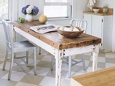 mismatched: modern metal chairs and a rustic farmhouse table.  Casual look without being old fashioned