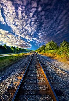 Don't be satisfied with standing still on your pile of gravel. Follow your dreams! Don't give up hope! - DdO:) - http://www.pinterest.com/DianaDeeOsborne/hope-and-dreams/ - Nice railroads track photo with billowing highway of fluffy clouds. A joyful Bible verse for my FREE SAFE MUSIC WEBSITE DianaDeeOsborneSongs .com - http://www.dianadeeosbornesongs.com/ - Ephesians 3:20, God can do FAR BEYOND ALL YOU ASK OR DREAM! Pinned via Susana Lara. PHOTO CREDIT: Phil Koch on flickr.