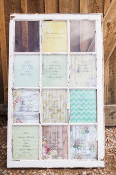 vintage window backed with patterned paper for a seating chart, photo by Rachel Havel http://ruffledblog.com/woodland-park-wedding #weddingideas #seatingchart