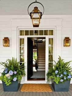 Hydrangeas, ferns, sweet potato vine make a great planter arrangement for the shade, and create a beautiful and welcoming vignette for this house. - randyinterior