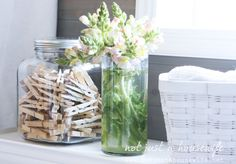 laundry room decor- like the jar of clothespins---I could do antique clothespins and paint them pale yellow and grey!
