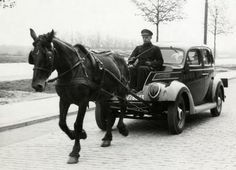 During the German occupation of The Netherlands people still used a car without gasoline/fuel because of shortages. In this picture a Ford V is drawn by a horse. The spot that would usually holds the engine is now being used as the drivers' seat. Holland, The Hague, May 14th 1941