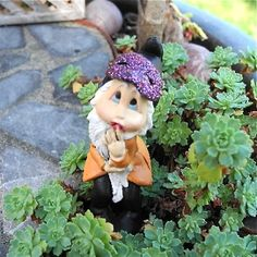 Miniature Garden Halloween Gnomes come staked to hold their place in the soil. #miniaturegarden #halloween