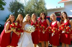 red bridesmaids dresses, yellow flowers