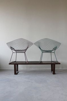 Two Bertoia chairs.
