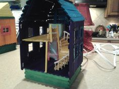 Blue & purple miniature 2-story house popsicle stick night light lamp. $8.95, via Etsy.