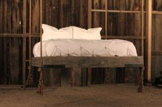 Hanging/suspended bed from reclaimed wood: http://benriddering.com/2012/04/27/hanging-bed/#