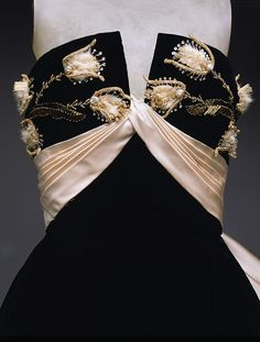 """Swoon. """"Ball gown, ca. 1951  Jacques Fath (French, 1912–1954)  Black silk velvet with ivory silk satin, white mink, and gold metal trim"""