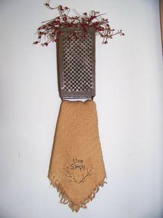 Primitive KITCHEN DECOR - use an old grater as a dishtowel holder