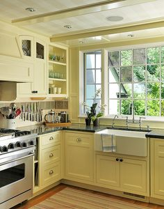 Kitchens red orange yellow cabinets on pinterest for Butter cream colored kitchen cabinets