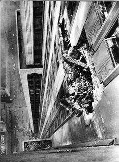 Hole where plane (B-25) hit Empire State Building, 1945.