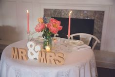 Head table with coral peonies - see more coral touches in this sweet KY wedding on the Blog