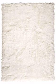 Affordable Faux sheepskin rug. Bedroom?