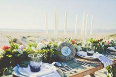 sea tablescape with tall skinny candles
