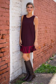 "With a shock of magenta tie-dye on the hem for a stunning look that's totally electric, this simple burgundy dress is an amazing addition to any fall wardrobe! It's a breeze to wear thanks to the loose shift style!   Bra-friendly!  Miranda is wearing the small.   Sizes fit:  Small- 0-4; Medium- 6, Large- 8-10  Length from shoulder to hem: S- 33""; M- 34""; L- 35""."