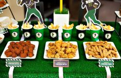 Use a green tablecloth with white duct tape!   snack station for football party