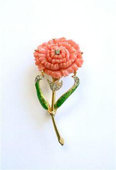 Vintage Hattie Carnegie flower brooch.  Green enamel, faux coral and rhinestones.
