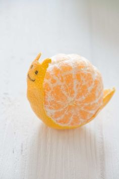 Tangerine snail! How cute, have the kids make this for a snack! From Little Cook Food And Fun