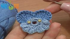 Crochet Beaded Center Pansy Flower Tutorial 64 Part 1 of 2 Quick to Crochet Two Color Pansy Flower  http://sheruknitting.com/videos-about-knitting/crochet-flower-lessons/item/479-crochet-pansy-flower.html This crocheted pansy flower made in two colors (two shades of blue) and decorated with two little yellow beads that were stitched to the center with the yarn needle.