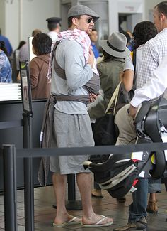 Aww! Channing Tatum holds daughter Everly in a sling while at the airport with wife, Jenna Dewan-Tatum