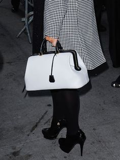 Color Duo  Kris Jenner's black and white doctor's bag goes perfectly with the rest of her two-tone ensemble.