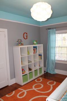 I have no need to look at children's rooms but this color combo caught my eye. May need this in the future. Gray room with Orange accents. Paint- Gray is Sparrow by Behr and blue is True Turquoise by Glidden