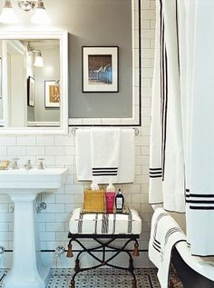 In Chloë Sevigny's Manhattan apartment, the bathroom is crisply done in black and white. #HouseandGarden