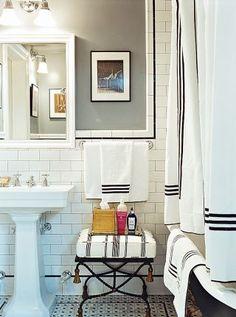 In Chloë Sevigny's Manhattan apartment, the bathroom is crisply done in black and white. #HouseandGarden chloe sevigny, bathroom interior design, modern bathroom design, black white, bathroom designs, white bathrooms, subway tiles, modern bathrooms, design bathroom