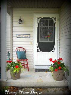 The cottage door, the red geraniums and the chair.