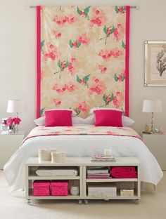 The draping for the headboard is not my thing but i do like the simple but still colourful bedding and the storage in front of the bed.