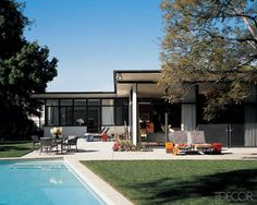The rear façade of Trina Turk and Jonathan Skow's house, designed in the 1940s by J. R. Davidson.
