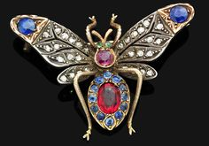 An antique gem-set butterfly brooch  Modelled as a butterfly, the pierced outstretched wings set with single-cut diamonds and circular-cut sapphires, the body designed as a ruby and sapphire cluster, to the emerald eye and ruby head detail, mounted in silver and gold, rubies approximately 3.00 carats total, sapphires approximately 1.00 carat total, width 4.5cm bee brooch, butterfli brooch, antiqu