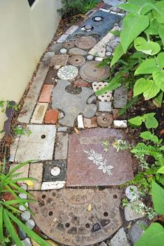 LOVE THIS found object pathway at the Organic Mechanics' Paradise Garden (from The Outlaw Gardener blog)