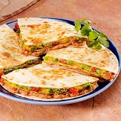 Crunchy Quesadilla Stack: Refried beans, spicy tomatoes, cheese, and avocado layered in tortilla and crunchy corn tostadas.