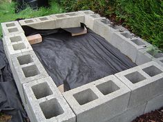 raised beds using cinderblocks - absorb and hold heat and double as additional planting space.