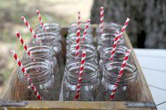 cute way to serve drinks. mason jars + striped straws.