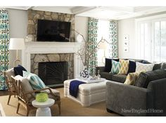patterned drapes, rock fireplace surround