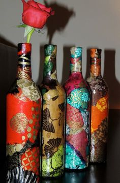 Modge Podge scrap book paper onto an old bottle of any size or shape - now you have a Beautiful Piece of Art.