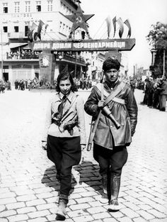 "Caption: ""Bulgarian communist partisans patrol the streets of Plovdiv in anticipation of the arriving Soviet Army. In the background, a banner reads ""Welcome the Red Army"". .... In September 1944, members of the Bulgarian Fatherland Front, an anti-Nazi resistance movement, staged a coup d'état and a new, communist government was appointed. Bulgaria then declared war on former allies Germany and Italy. Plovdiv, Plovdiv Province, Bulgaria. September 1944."""
