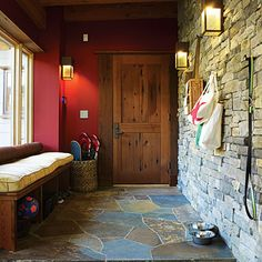 Tahoe Idea House Mudroom ~ I LOVE the stacked rock wall and slate floors!