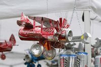 Soda can airplane. More instructions are also here: http://www.ehow.com/how_5885881_make-coke-can-airplane.html