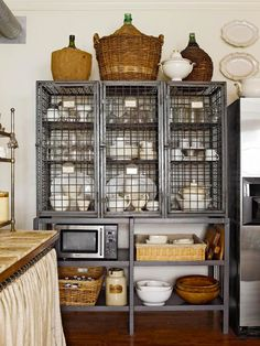 antique wine cage repurposed to hold dish ware collection
