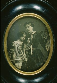 Portrait of a woman and girl with dog, ca. 1855.